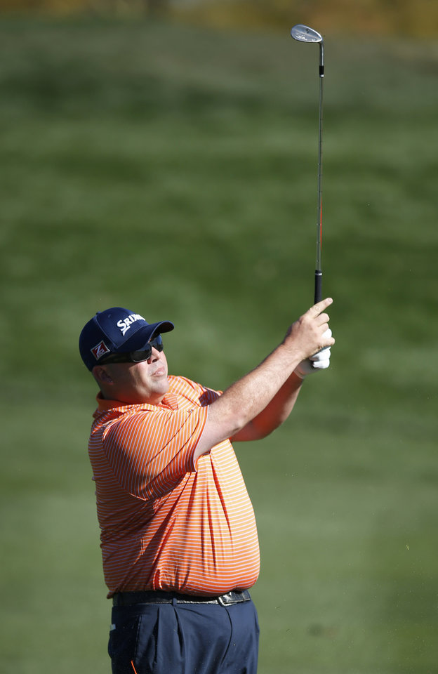 Photo - Kevin Stadler hits his approach shot onto the second green during the final round of the Phoenix Open golf tournament on Sunday, Feb. 2, 2014, in Scottsdale, Ariz. (AP Photo/Ross D. Franklin)