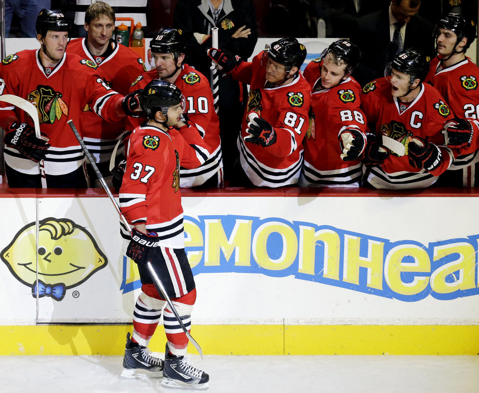 Chicago Blackhawks' Brandon Pirri (37) celebrates with teammates after scoring a goal against Phoenix Coyotes goalie Mike Smith in a shootout during an NHL hockey game in Chicago, Thursday, Nov. 14, 2013. The Blackhawks won 5-4. (AP Photo/Nam Y. Huh)