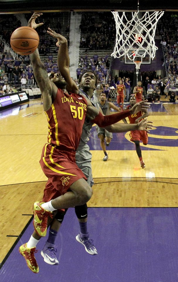 Photo - Iowa State's DeAndre Kane (50) is fouled by Kansas State's Nino Williams during the first half of an NCAA college basketball game Saturday, March 1, 2014, in Manhattan, Kan. (AP Photo/Charlie Riedel)