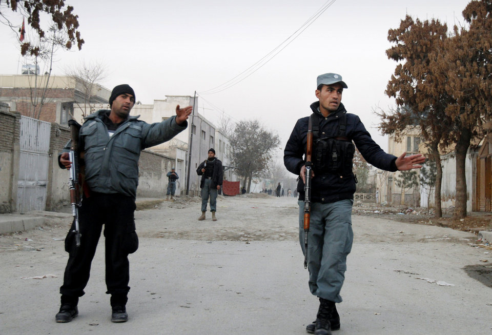 Afghan policemen stand gurad near the scene where Afghanistan's Intelligence Chief Asadullah Khalid was wounded in an assassination attempt in Kabul, Afghanistan, Thursday, Dec. 6, 2012. Afghanistan's intelligence chief was wounded Thursday in an assassination attempt in the capital, Kabul, Afghan officials said. (AP Photo/Ahmad Jamshid)