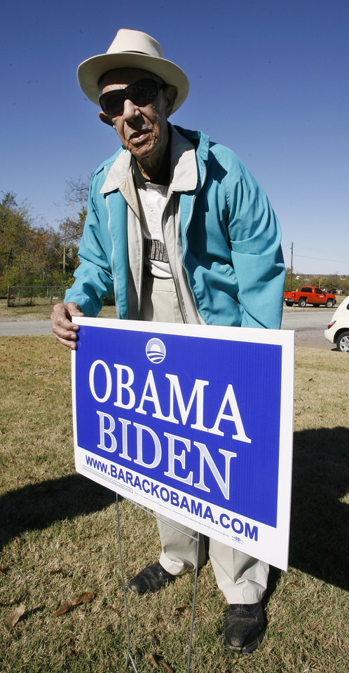 Oklahoma City resident Robert Jones, 103, at his home standing with the Obama sign in his front yard in Oklahoma City Thursday, Nov. 6, 2008, while talking about this week's presidential election. BY PAUL B. SOUTHERLAND, THE OKLAHOMAN
