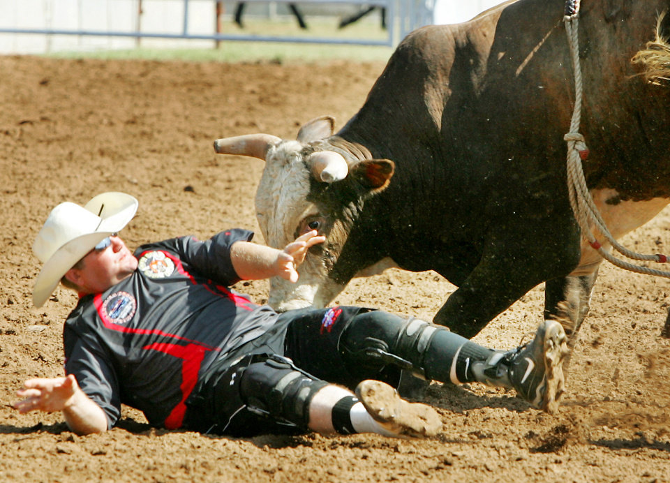 Bull fighter Rob Gan of Lonoke, AR gets up after being knocked on his back during the bull riding competition at the International Finals Youth Rodeo at the Expo Center in Shawnee , Okla. July 14 , 2008.  BY STEVE GOOCH, THE  OKLAHOMAN.