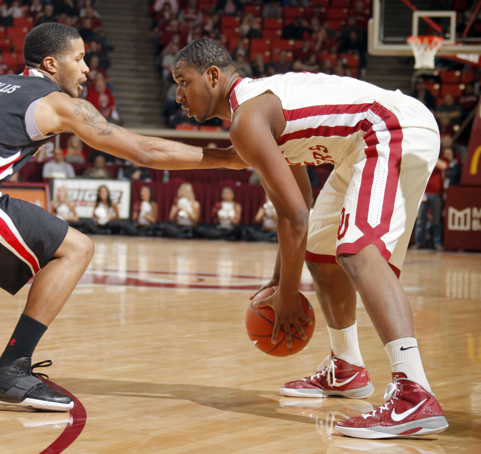 Photo - Oklahoma's Steven Pledger (2) looks to get by Texas Tech's Javarez Willis (5)during the men's college basketball game between the University of Oklahoma  and Texas Tech University of at the Lloyd Nobel Center in Norman, Okla., Tuesday, Jan. 17, 2012. Photo by Sarah Phipps, The Oklahoman