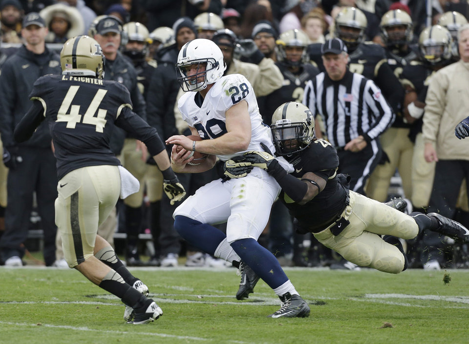 Photo -   Penn State running back Zach Zwinak is tackled by Purdue's Landon Feichter (44) and Josh Johnson (28) during the first half of an NCAA college football game Saturday, Nov. 3, 2012, in West Lafayette, Ind. (AP Photo/Darron Cummings