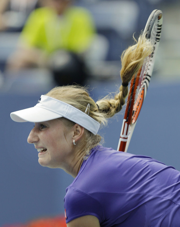 Photo -   Russia's Ekaterina Makarova returns a shot to Serena Williams in the third round of play at the 2012 US Open tennis tournament, Saturday, Sept. 1, 2012, in New York. (AP Photo/Kathy Willens)