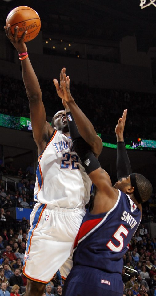 Oklahoma City's Jeff Green (22) shoots over Josh Smith (5) of Atlanta during the NBA basketball game between the Atlanta Hawks and the Oklahoma City Thunder at the Ford Center in Oklahoma City, Tuesday, February 2, 2010. Photo by Nate Billings, The Oklahoman