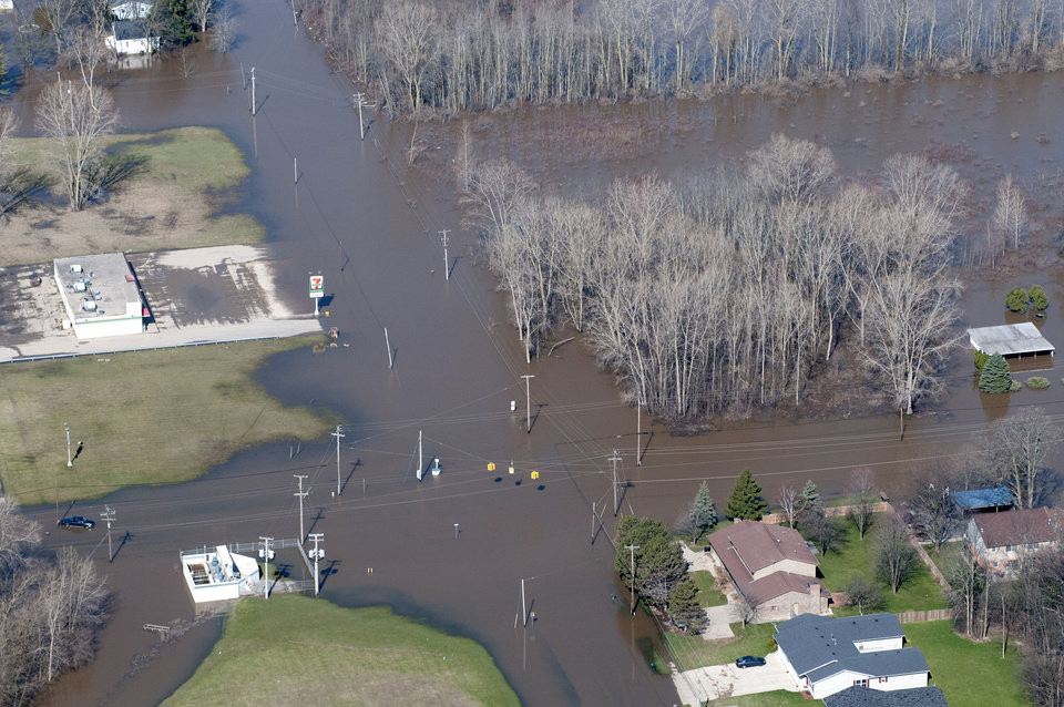 The intersection of West Michigan and South Center in Saginaw Township remains flooded and impassable on Monday, April 22, 2013. A pickup truck is still stranded in the water at lower left. Area rivers overflowed their banks over the weekend after days of heavy rain saturated the ground. (AP Photo/Jeff Schrier, The Saginaw News)