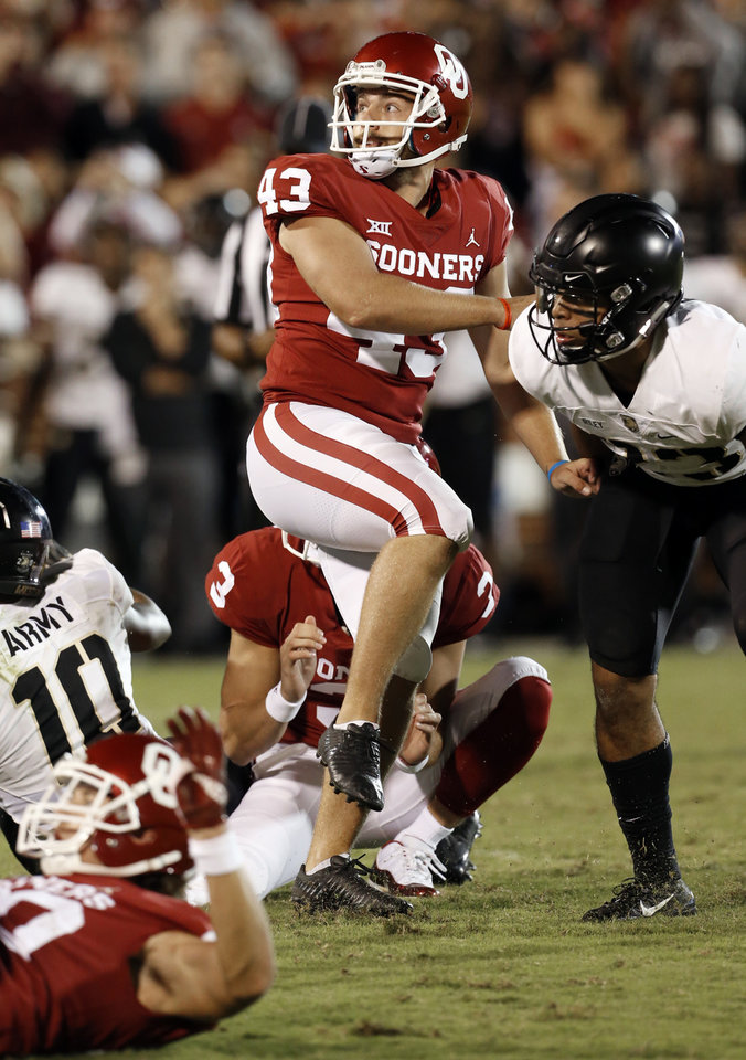 Photo - Oklahoma's Austin Seibert (43) watches a potential game winning field goal miss during a college football game in which the University of Oklahoma Sooners (OU) defeated the Army Black Knights 28-21 at Gaylord Family-Oklahoma Memorial Stadium in Norman, Okla., on Saturday, Sept. 22, 2018. Photo by Steve Sisney, The Oklahoman