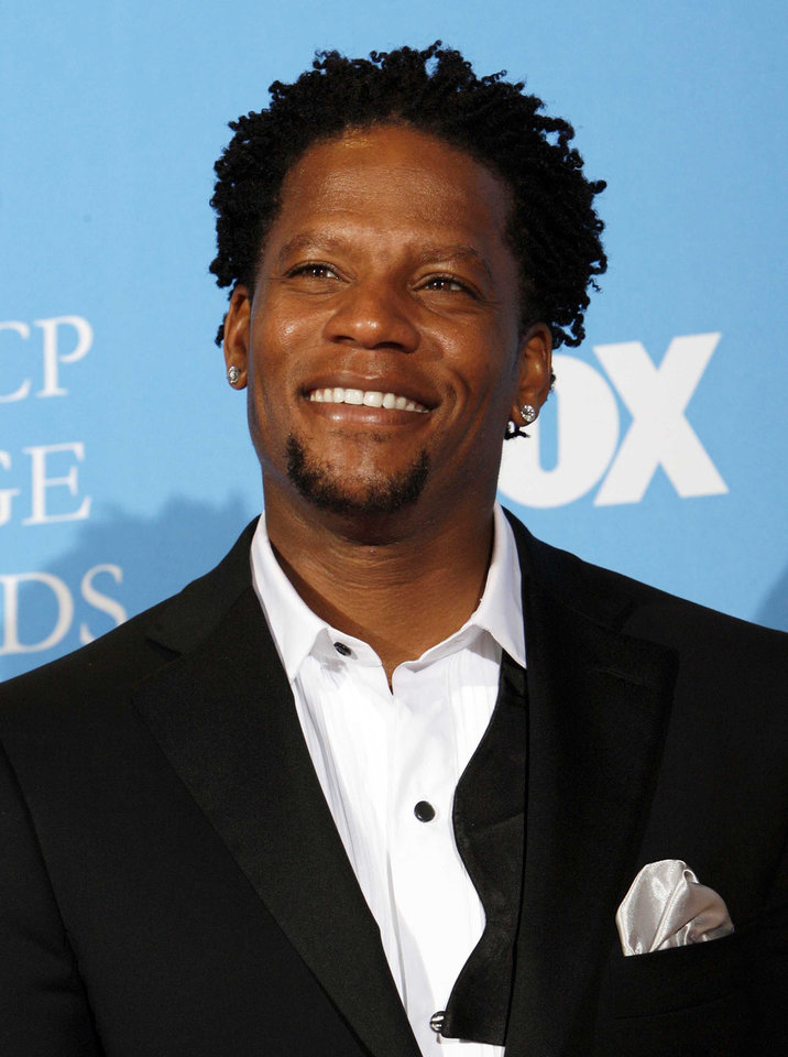 "FILE - In this Feb. 14, 2008 file photo, D.L. Hughley poses in the press room  at the 39th NAACP Image Awards in Los Angeles. Hughley  is one of eleven celebrity contestants who will compete on the next edition of ""Dancing with the Stars."" The new season kicks off on ABC with a two-hour premiere on March 18. (AP Photo/Gus Ruelas, file)"