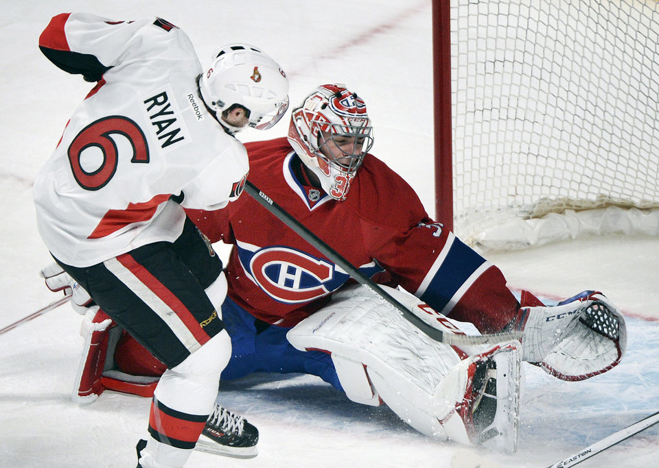 Photo - Montreal Canadiens goaltender Carey Price, right, makes a save against Ottawa Senators' Bobby Ryan during the first period of an NHL hockey game in Montreal, Saturday, Jan. 4, 2014. (AP Photo/The Canadian Press, Graham Hughes)