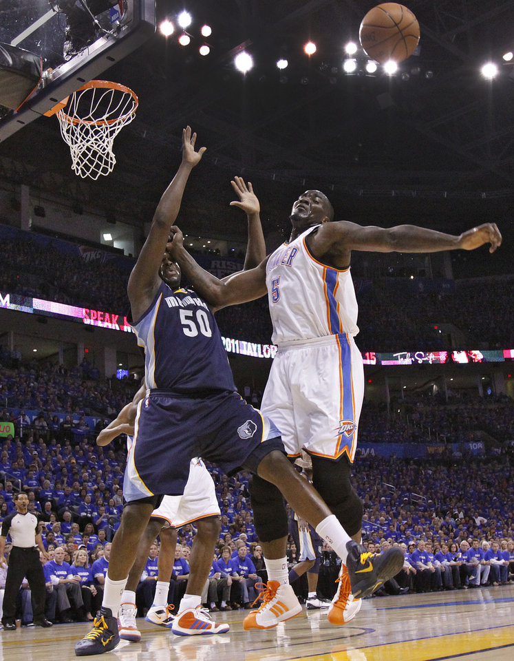 Photo - Oklahoma City's Kendrick Perkins (5) battles with Zach Randolph (50) of Memphis during game two of the Western Conference semifinals between the Memphis Grizzlies and the Oklahoma City Thunder in the NBA basketball playoffs at Oklahoma City Arena in Oklahoma City, Tuesday, May 3, 2011. Photo by Chris Landsberger, The Oklahoman