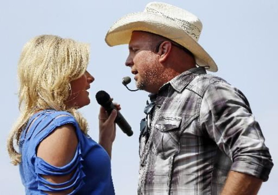 Photo -  Trisha Yearwood and Garth Brooks perform during the Oklahoma Twister Relief Concert, benefiting victims of the May tornadoes, at Gaylord Family - Oklahoma Memorial Stadium on the campus of the University of Oklahoma in Norman, Okla., Saturday, July 6, 2013. Photo by Nate Billings, The Oklahoman