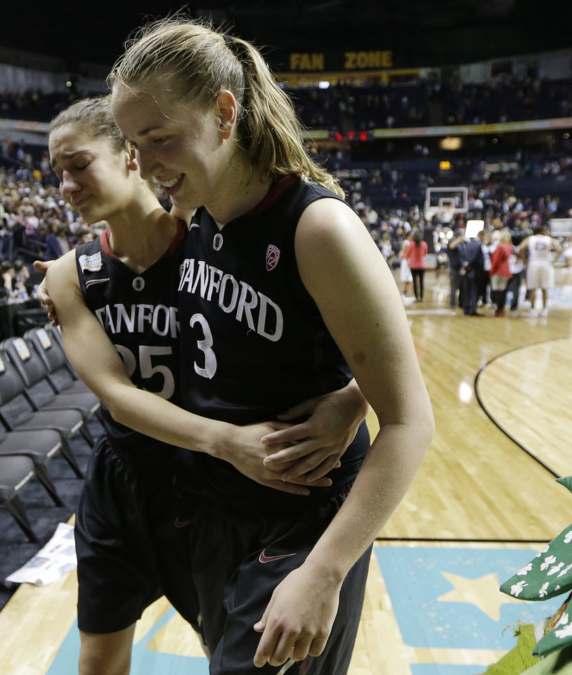 Photo - Stanford forward Erica Payne, left and Stanford forward Mikaela Ruef walk off the court after the second half of the semifinal game against Connecticut in the Final Four of the NCAA women's college basketball tournament, Sunday, April 6, 2014, in Nashville, Tenn. Connecticut won 75.56. (AP Photo/Mark Humphrey)