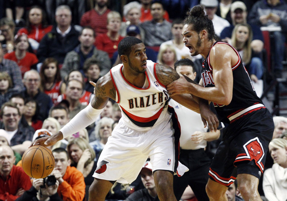 Portland Trail Blazers forward LaMarcus Aldridge, left, looks for room to maneuver against Chicago Bulls center Joakim Noah during the first quarter of their NBA basketball game in Portland, Ore., Sunday, Nov. 18, 2012. (AP Photo/Don Ryan)