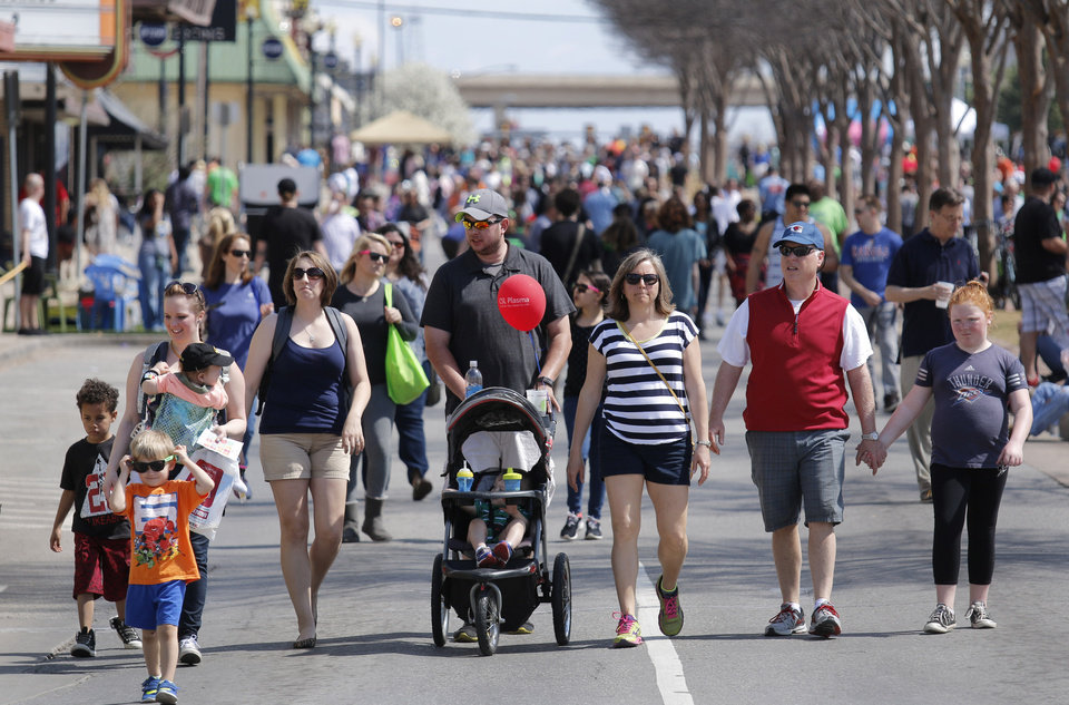 Photo - People enjoy a beautiful spring day at Open Streets OKC, along NW 23rd Street between Robinson and Western, Sunday, March 22, 2015. Photo by Doug Hoke, The Oklahoman