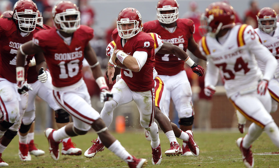 Oklahoma's Trevor Knight (9) runs through the Iowa State defense for a touchdown during the college football game between the University of Oklahoma Sooners (OU) and the Iowa State University Cyclones (ISU) at Gaylord Family-Oklahoma Memorial Stadium in Norman, Okla. on Saturday, Nov. 16, 2013. Photo by Chris Landsberger, The Oklahoman