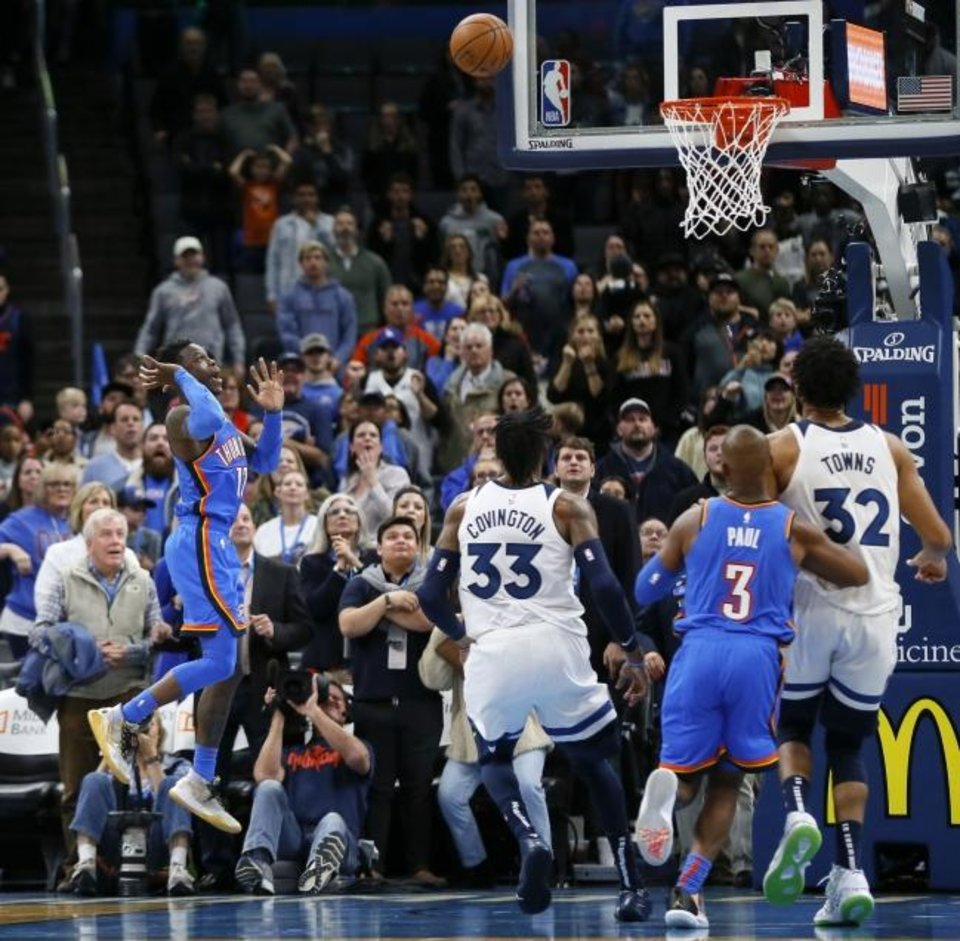 Photo -  Dennis Schroder, left, watches his shot to send a Dec. 6 game against Minnesota into overtime. The Thunder won 139-127 at Chesapeake Energy Arena. [Nate Billings/The Oklahoman]