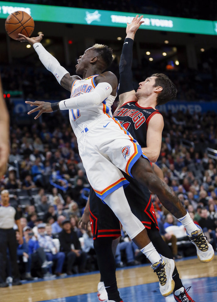 Photo - Oklahoma City's Dennis Schroder (17) shoots past Chicago's Ryan Arcidiacono (51) in the second quarter during an NBA basketball game between the Oklahoma City Thunder and Chicago Bulls at Chesapeake Energy Arena in Oklahoma City, Monday, Dec. 16, 2019. [Nate Billings/The Oklahoman]