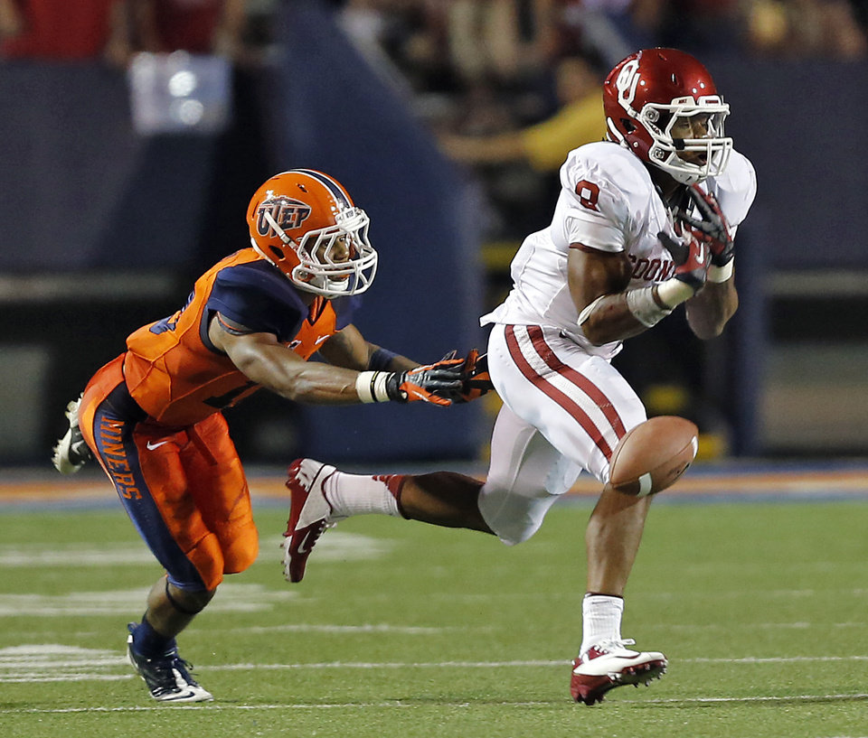 Photo - Oklahoma Sooners running back Dominique Whaley (8) misses a catch in front of UTEP Miners defensive back Drew Thomas (10) during the college football game between the University of Oklahoma Sooners (OU) and the University of Texas El Paso Miners (UTEP) at Sun Bowl Stadium on Saturday, Sept. 1, 2012, in El Paso, Tex.  Photo by Chris Landsberger, The Oklahoman