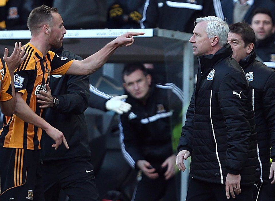 Photo - Newcastle United's manager Alan Pardew,  right,  and Hull City's David Meyler, left, confront each other during the during the English Premier League match at the KC Stadium, Hull England Saturday March 1, 2014. (AP Photo/Lynne Cameron/PA)  UNITED KINGDOM OUT