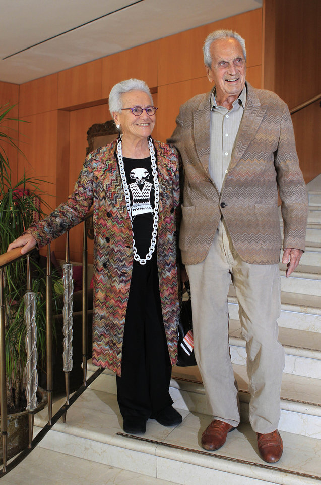 Photo - In this photo taken on March 22, 2012 Italian fashion designer Ottavio Missoni is flanked by his wife Rosita Jelimini in Milan, Italy. Italian fashion company Missoni says its co-founder, Ottavio Missoni, has died in his home earlier on Thursday, May 9, 2013 in northern Italy. Missoni, who was 92, founded the iconic fashion brand of zigzagged-patterned knitwear along with his wife, Rosita, in 1953. The Missonis are a family fashion dynasty, with the couple's children and their offspring involved in expanding the brand. (AP Photo/Luca Bruno)