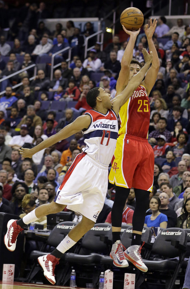 Houston Rockets forward Chandler Parsons (25) shoots in front of Washington Wizards guard Garrett Temple (17) in the first half of an NBA basketball game, Saturday, Feb. 23, 2013, in Washington. (AP Photo/Alex Brandon)
