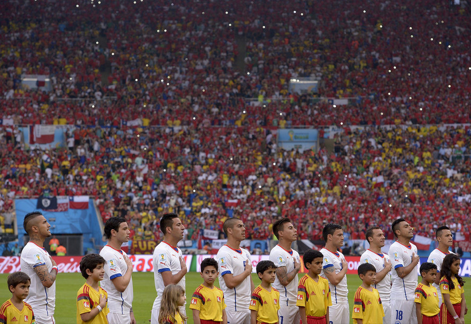 Photo - The Chilean team line up for the national anthem before the group B World Cup soccer match between Spain and Chile at the Maracana Stadium in Rio de Janeiro, Brazil, Wednesday, June 18, 2014.  (AP Photo/Manu Fernandez)