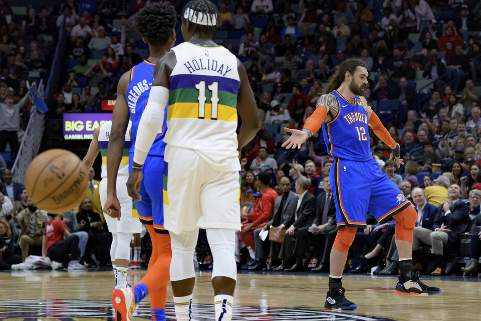 Photo - Oklahoma City Thunder center Steven Adams (12) celebrates a basket from half-court against the New Orleans Pelicans during the first half of an NBA basketball game in New Orleans, Thursday, Feb. 13, 2020. (AP Photo/Matthew Hinton)