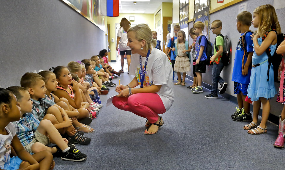 Photo - Teacher Tiffany Dooley takes roll of her class before going to the classroom on the first day of school at Deer Creek's Prairie Vale Elementary on Thursday, Aug. 13, 2015, in Edmond, Okla. Photo by Chris Landsberger, The Oklahoman