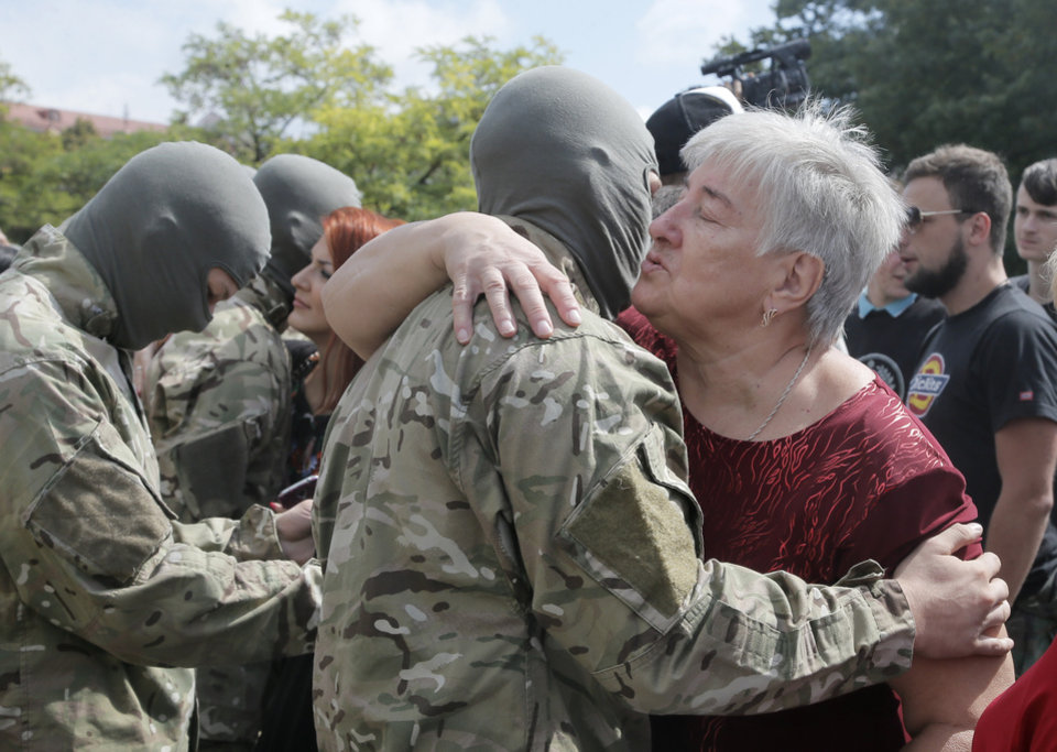 Photo - Friends and relatives say goodbye to volunteers before they were sent to the eastern part of Ukraine to join the ranks of special battalion