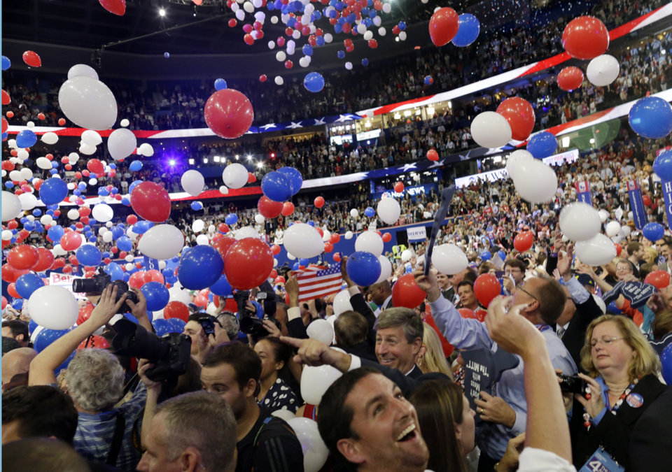 Photo -   Balloons fall as Republican presidential nominee Mitt Romney and Republican vice presidential nominee, Rep. Paul Ryan's families take the stage at the Republican National Convention in Tampa, Fla., on Thursday, Aug. 30, 2012. (AP Photo/Charles Dharapak)