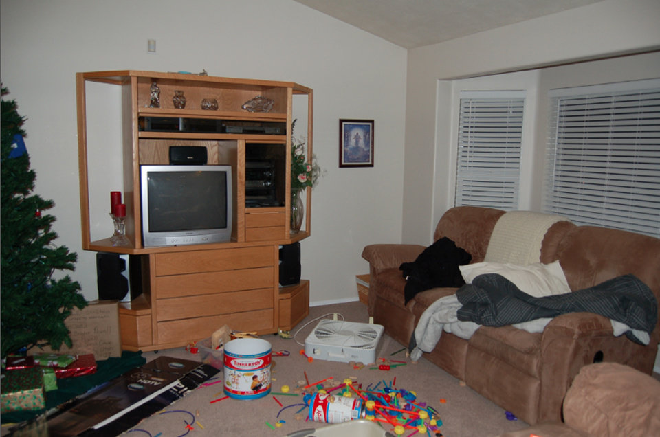 Photo - This undated evidence photo released Monday, May 20, 2013, by the West Valley City Police Department shows the living room of Josh and Susan Powell's house. Citing a lack of leads, a police agency said Monday that it is closing the active investigation of the disappearance of Susan Powell, a Utah mother whose now-dead husband was a prime suspect. West Valley City police called the news conference to offer new details in the case that's been largely kept under wraps since Powell vanished in 2009. The announcement came after police spent two days searching in rural Oregon last week for any trace of Powell's body. Police released the case file, which includes details that have been kept under wraps since Powell vanished in 2009. (AP Photo/West Valley City Police Department)
