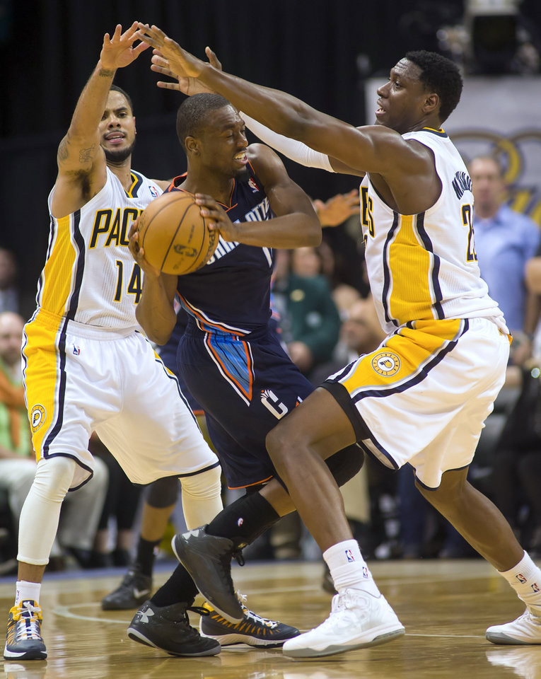 Kemba Walker (15) drives against Indiana Pacers' D.J. Augustin (14), left, and Ian Mahinmi (28) during the second half of an NBA basketball game in Indianapolis, Saturday, Jan. 12, 2013. The Pacers defeated the Bobcats 96-88. (AP Photo/Doug McSchooler)