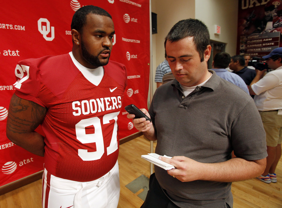 Photo - Jamarkus McFarland (97) speaks with The Oklahoman's Ryan Aber during the Meet the Sooners event at the University of Oklahoma on Saturday, Aug. 4, 2012, in Norman, Okla.  Photo by Steve Sisney, The Oklahoman