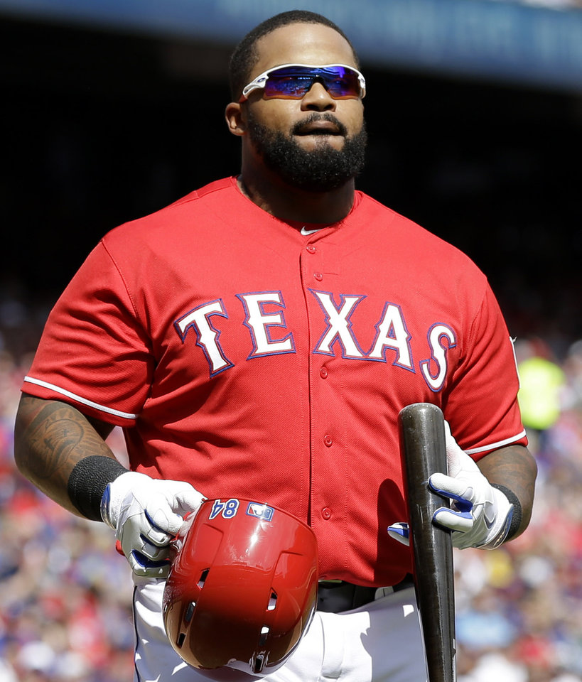 Photo - Texas Rangers' Prince Fielder heads to the dugout after being called out on strikes during the sixth inning of an opening day baseball game against the Philadelphia Phillies at Globe Life Park, Monday, March 31, 2014, in Arlington, Texas.  (AP Photo/Tony Gutierrez)