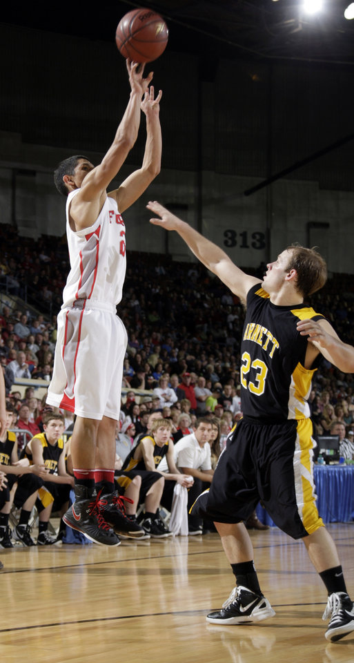 Photo - Forgan's Trent Brown shoots as Arnett's Jason Johnson defends during the Class B boys state championship high school basketball game  at the State Fair Arena in Oklahoma City,  Saturday, March 3, 2012. Photo by Sarah Phipps, The Oklahoman