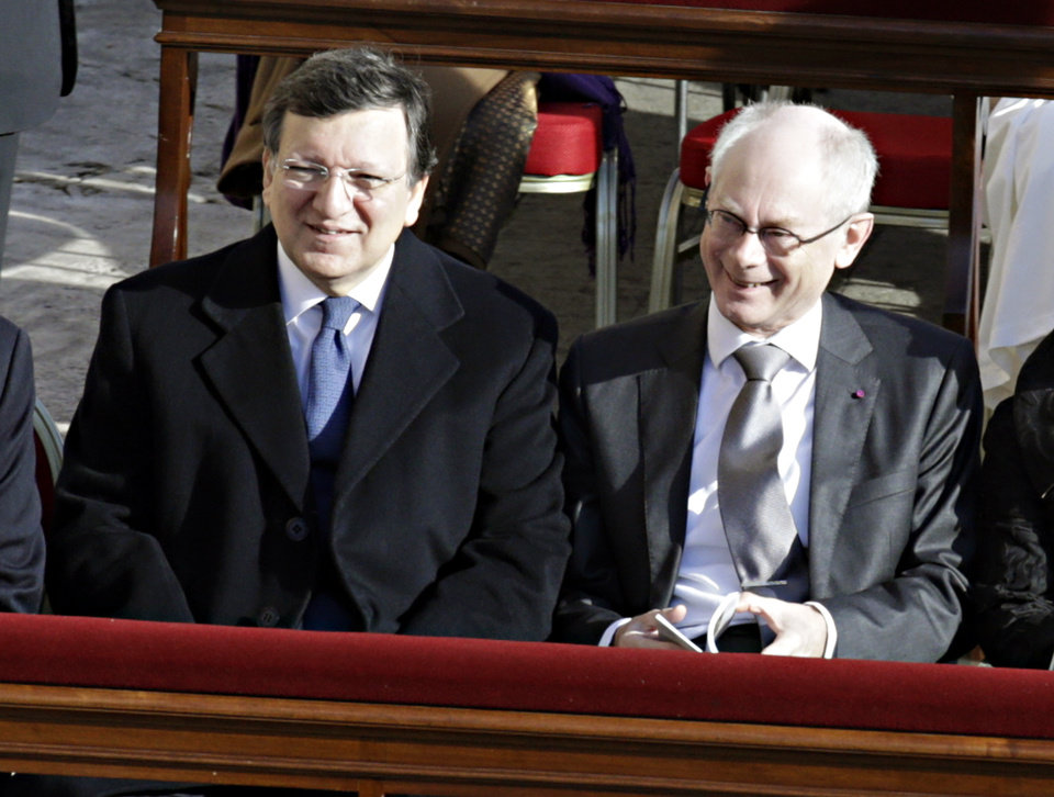 European Commission President Jose Manuel Barroso, left, and European Council President Herman Van Rompuy take their seats for the inaugural Mass of Pope Francis, at the Vatican, Tuesday, March 19, 2013. (AP Photo/Andrew Medichini)