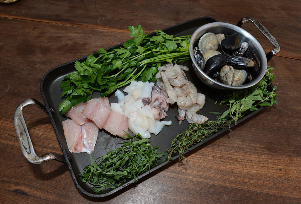 Fresh fish, squid, shrimp and clams are important main ingredients in making the Italian Fish Soup. (Johnny Crawford/Atlanta Journal-Constitution/MCT)