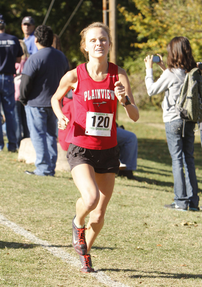 Photo - Plainview's Alex Davis maintains a healthy lead during the class 3A girls State cross country meet at Gordon Cooper Vo-Tech in Shawnee, OK, Saturday, October 20, 2012. She went on to win the 3A meet.  By Paul Hellstern, The Oklahoman