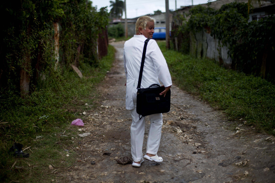 Adela Hernandez, 48, walks through her village of Caibarien, Cuba, Friday, Nov. 16, 2012. Hernandez, a biologically male Cuban who has lived as a female since childhood, served two years in prison in the 1980s for