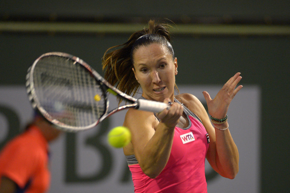 Photo - Jelena Jankovic, of Serbia, returns a shot to Yvonne Meusburger, of Austria, during their match at the BNP Paribas Open tennis tournament on Friday, March 7, 2014, in Indian Wells, Calif. (AP Photo/Mark J. Terrill)
