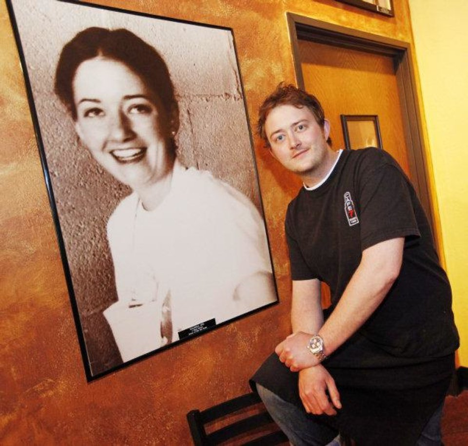 Cafe 7 owner Jimmy Mays poses next to a photo of his mother, Jeri Mays, on the wall at Cafe 7 in Oklahoma City, Friday, April 22, 2011. Photo by Nate Billings, The Oklahoman ORG XMIT: KOD