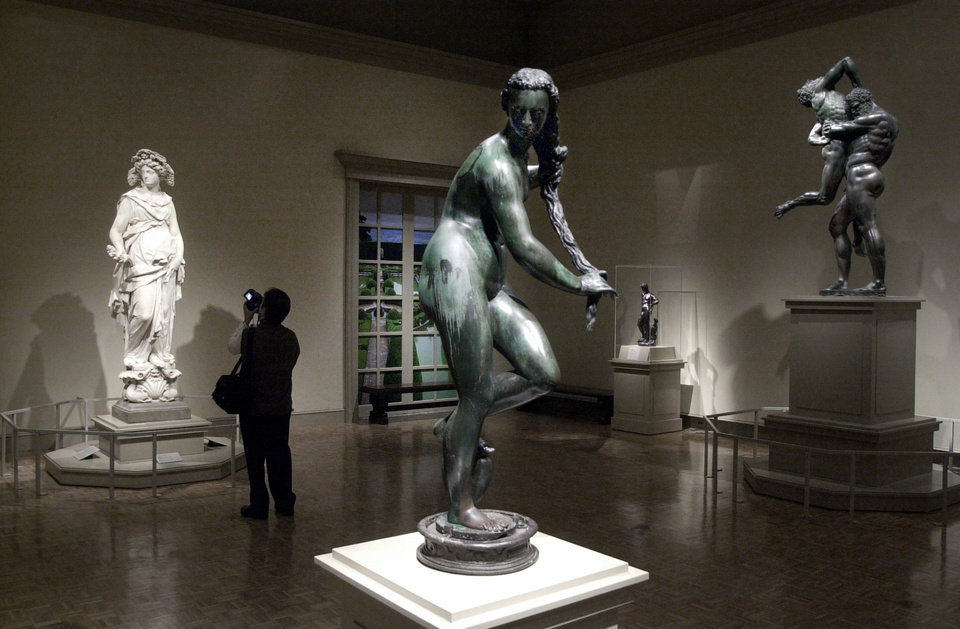 Photo - FILE-- In this March 13, 2003 file photo, a woman views Italian sculptures at the