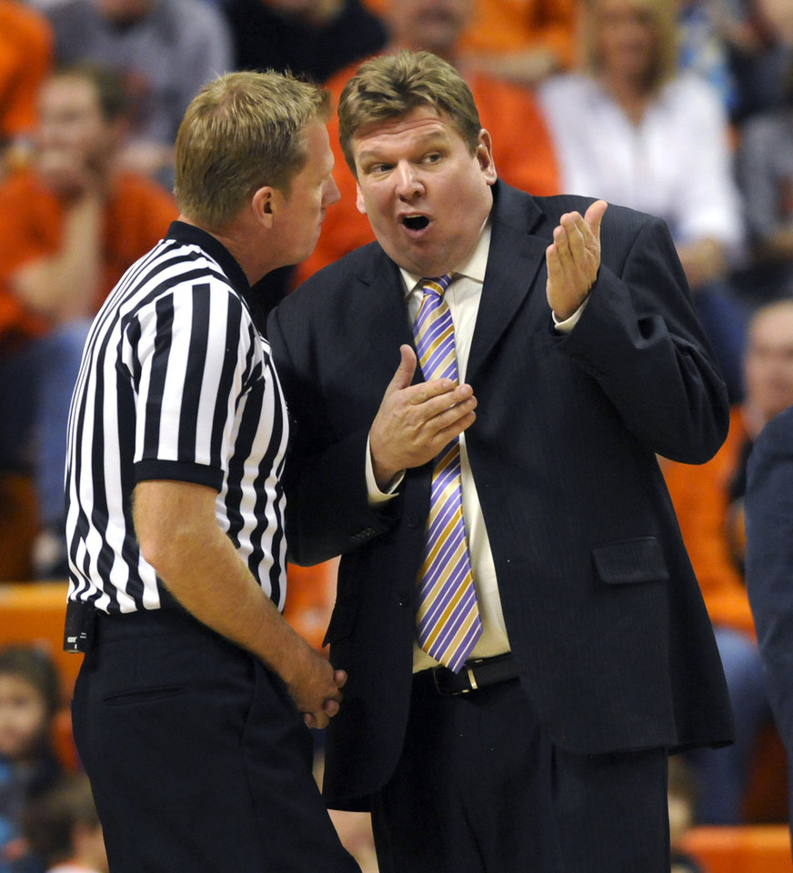 Photo - Tennessee head coach Steve Payne, right, argues with a referee after getting a technical during the second half of an NCAA college basketball game against Oklahoma State, Saturday, Dec. 22, 2012, in Stillwater, Okla. Oklahoma State defeated Tennessee Tech 78-42. (AP Photo/Brody Schmidt)