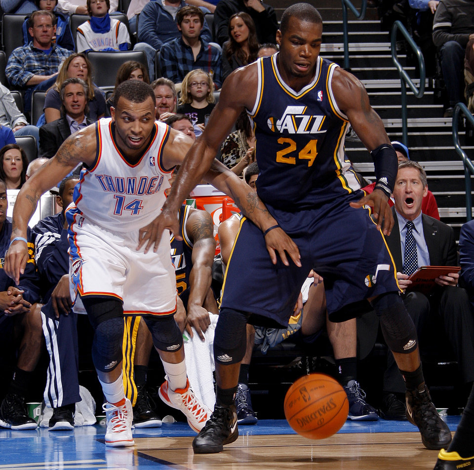 Oklahoma City's Daequan Cook (14) tries to steal the ball from Utah's Paul Millsap (24)  during an NBA game between the Oklahoma City Thunder and the Utah Jazz at Chesapeake Energy Arena in Oklahoma CIty, Tuesday, Feb. 14, 2012. Photo by Bryan Terry, The Oklahoman
