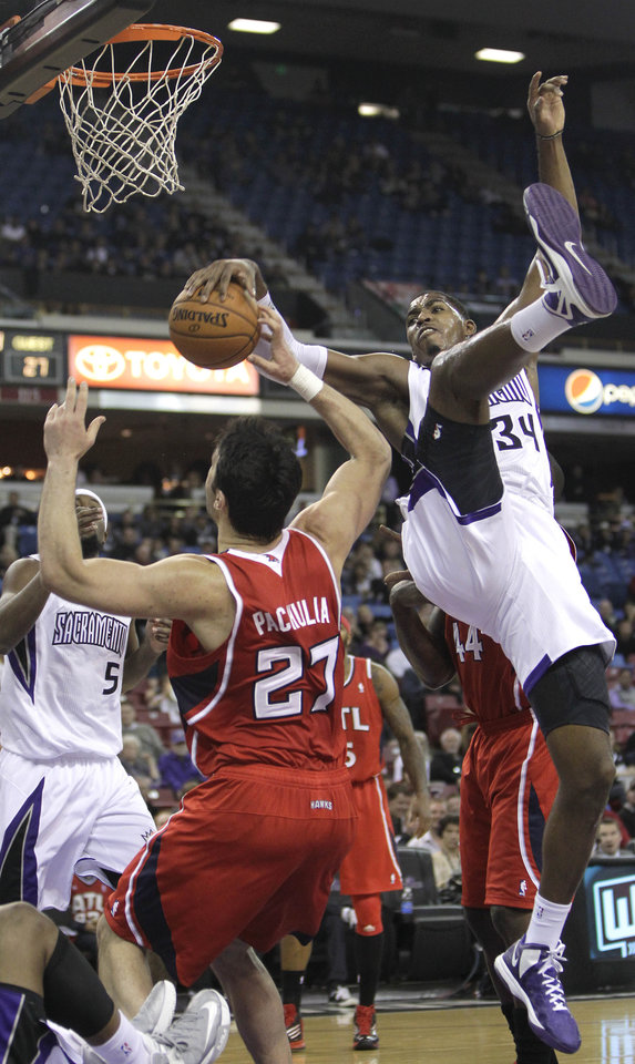 Atlanta Hawks center Zaza Pachulia, front left,of Georgia, is fouled by Sacramento Kings forward Jason Thompson (34) during the first half of an NBA basketball game in Sacramento, Calif., Friday, Nov. 16, 2012. (AP Photo/Rich Pedroncelli)