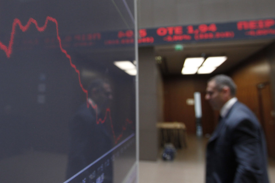 Photo -   A man is reflected in the chart with stock prices at the Greek Stock Exchange in Athens, Monday, May 14, 2012. Greek party leaders are to resume power-sharing talks Monday as negotiations to create a government drag into a second week, raising the specter of fresh elections that could threaten the crisis-stricken country's international bailout and its membership of the euro. (AP Photo/Petros Giannakouris)