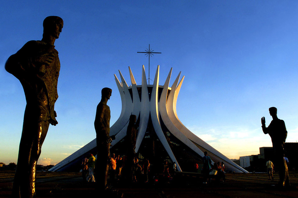 Photo - FILE - In this April 21, 2003 file photo, the statues of the apostles are seen in front of the Cathedral of Brasilia, an architectural landmark created by architect Oscar Niemeyer, in Brasilia, Brazil.  According to a hospital spokeswoman on Wednesday, Dec. 5, 2012, famed Brazilian architect Oscar Niemeyer has died at age 104.  (AP Photo/Eraldo Peres, File)