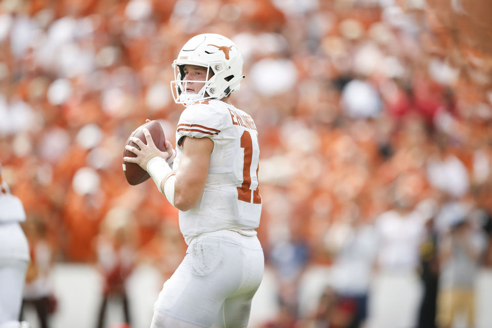Photo - Texas Longhorns quarterback Sam Ehlinger (11) attempts a pass during the Red River Showdown between the Texas Longhorns and the Oklahoma Sooners at Cotton Bowl Stadium on Saturday, October 06, 2018. IAN MAULE/Tulsa World