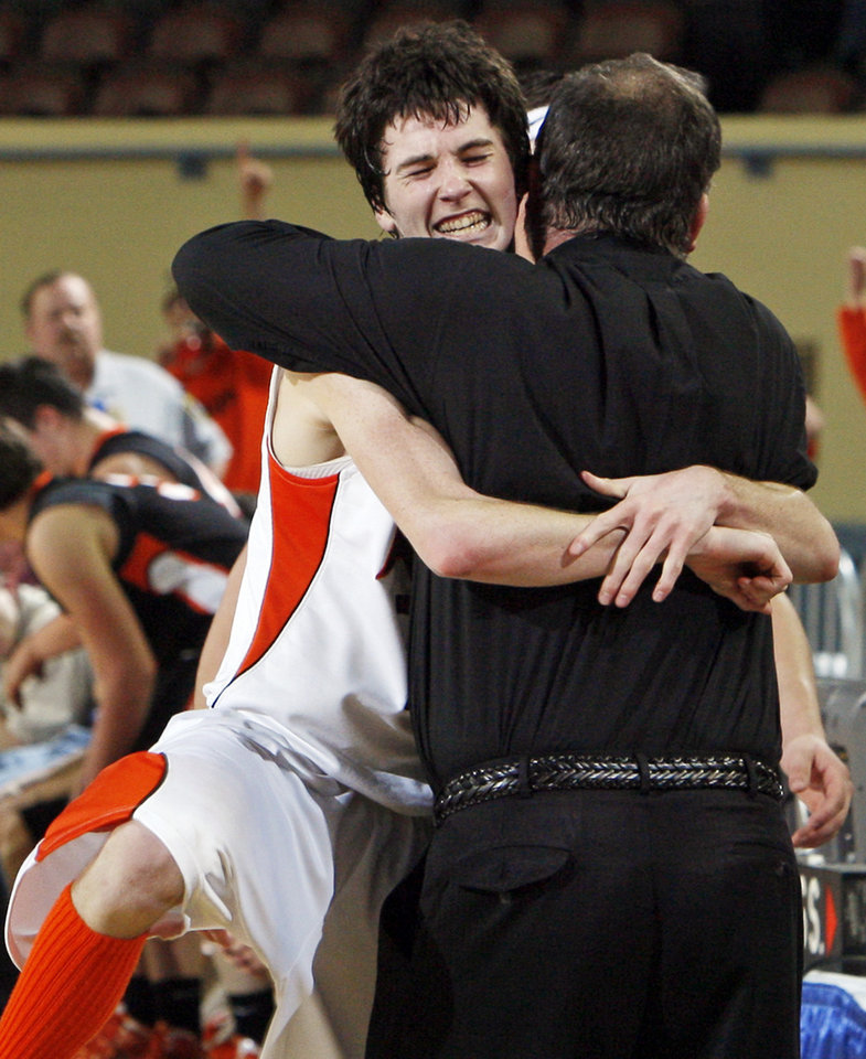 Photo - Cheyenne-Reydon's Austin Thrash (12) hugs his father and coach, Brad Thrash, late in the Class A boys state championship high school basketball game between Cheyenne-Reydon and Merritt at State Fair Arena in Oklahoma City, Saturday, March 3, 2012. Cheyenne-Reydon won, 51-30. Photo by Nate Billings, The Oklahoman